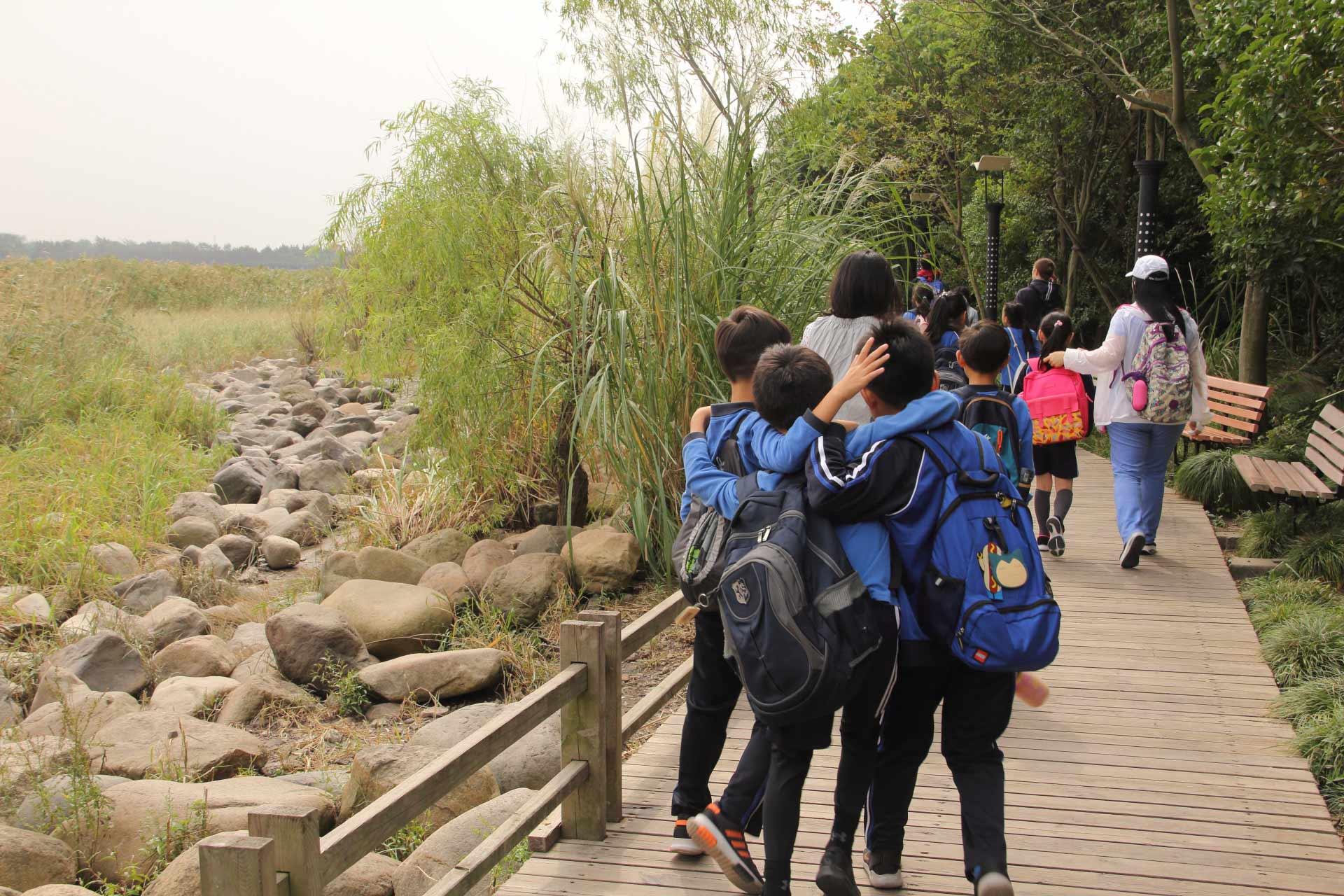 school class in nature on bridge